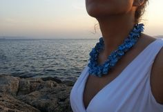 necklace with handmade blue petals of polymer clay