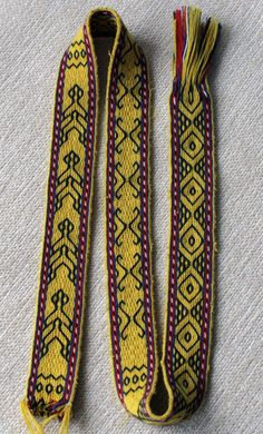 Double-faced tablet woven band from Sulawesi. The pattern area is threaded with one  black and three yellow threads