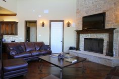 Rock fireplace with dark wood floors! www.johnjohnsoncustomhomes.com