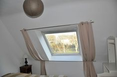 curtain for velux Source by Skylight Shade, Skylight Design, Cosy Bedroom, Bedroom Storage, Window Curtain Designs, Mezzanine Bedroom, Attic Rooms, Room Interior, Home Projects