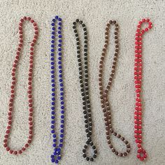 HOLIDAY SALE🎅🏻Vintage silk bead necklaces Vintage silk bead necklaces from the Philippines.  Small silk beads interspersed with gold spacers.  Rich, dark colors - burgundy, royal blue, black, brown, and red.  Set of 5. Jewelry Necklaces