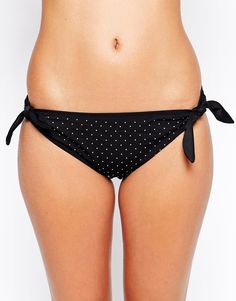 Bikini briefs by Marie Meili Low-cut, hipster rise Embellished design Side tie fastening Flattering, full brief back Hand wash