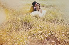 Beautiful wedding! Love this framing of a couple in a field of daisies.