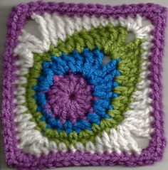 Peacock feather: FREE pattern crochet square, afghan square, crochet motif, crochet pattern by April Garwood of Banana Moon Studio. Free Crochet Square, Crochet Motifs, Granny Square Crochet Pattern, Filet Crochet, Crochet Afghans, Knit Crochet, Crochet Stitch, Granny Square Tutorial, Ravelry Crochet