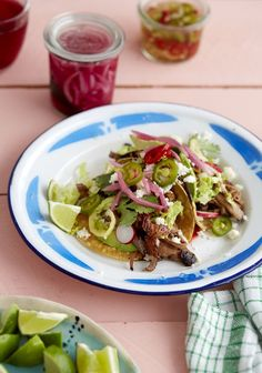 There are very few foods that feed a large crowd with little effort. Tacos may be the simplest option for feeding a lot of people, and today we are bringing you one of our favorite taco stuffings: barbacoa beef, tender and full of rich, complex flavors. Yes, did you know you can make that tasty stuff you buy at Chipotle in your own kitchen — and in your slow cooker, no less?