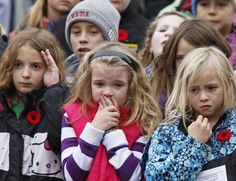 Grade 3 students during the playing of the Last Post during a 2013 Remembrance Day service at the Cenotaph in Bridgenorth, Ont. (Clifford Skarstedt/QMI AGENCY)
