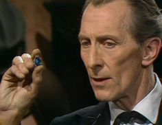 Peter Cushing's Sherlock Holmes character holding the blue carbuncle. – BBC  Television