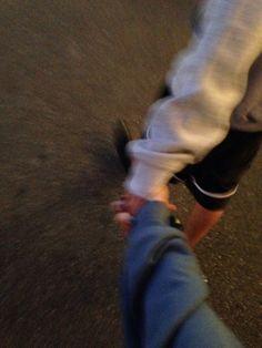 Walks, holding hands