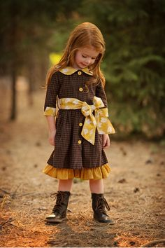 Brown Swiss Dress- love how the brown dress appears to be layered over the yellow dress. hmmm