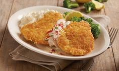 Parmesan Crusted Chicken Breast - Topped with lemon Chardonnay butter sauce, sun-dried tomatoes, fresh basil and Parmesan cheese. Served with white cheddar mashed potatoes and steamed broccoli.