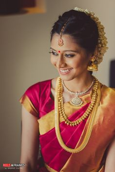 Real Indian Weddings - Saaksha and Karan | WedMeGood | Beautiful South Indian Bride in a Silk Marsala and Gold Saree and Gold Jewelry and Maang Tikka, Gajra in Hair #wedmegood #realwedding #indianwedding #indianbride