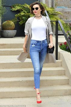 Miranda Kerr wearing Mother Stunner Ankle Fray Jeans in Graffiti Girl, Swarovski Duo Evil Eye Bangle, Celine Symmetrical Bag, Celine Cl41373 Lea Sunglasses, Aquazzura Allure Lace-Up Suede Pumps and Acne Studios Bliss C Tee