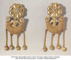 Ancient Greek earrings, end of the 5th c. B.C.E., decorated with a siren and seashells.
