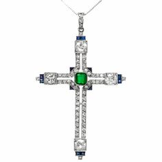 Art Deco Emerald Sapphire Diamond Platinum Cross Pendant | From a unique collection of vintage more jewelry at https://www.1stdibs.com/jewelry/more-jewelry-watches/more-jewelry/
