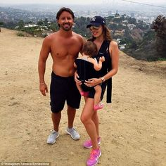 Picture perfect: Tamara Ecclestone and her husband Jay Rutland posed for a photo against t...