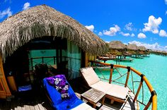 This is taken in  Bora Bora, which is in Tahiti..It's perfect for romantic travels! Beautiful clear blue waters