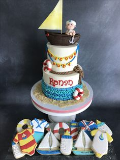Nautical themed buttercream baby boy shower cake and coordinating cookies. Baby Shower Cakes For Boys, Baby Boy Shower, Nautical Theme, Custom Cakes, Primary Colors, Sweet Treats, Birthday Cake, Cookies, Sailboat