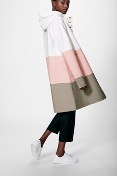 The Stutterheim Stockholm Large Stripe Pale Pink raincoat quotes Alexander Stutterheim's grandfather's original raincoat. It is handmade in rubberized cotton, comes unlined, with double welded seams, snap closures and cotton drawstrings. The finest crafts