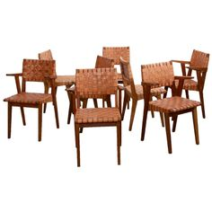 Set Of 8 Jens Risom 666W Chairs in Leather for Knoll in Solid Oak | From a unique collection of antique and modern dining room chairs at http://www.1stdibs.com/furniture/seating/dining-room-chairs/