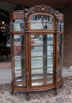 Quartersawn Oak Winged Angel Curved Glass China Cabinet