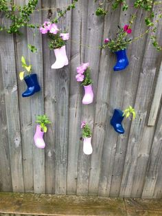 Gumboots hanging on the fence as plants