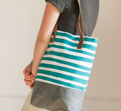 ON SALE!! WAS $109 NOW $85 Our favorite carry all tote featuring our graphic…