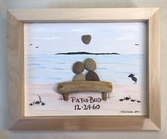 Pebble art in a shadow box, happy anniversary to the perfect couple snuggling on the beach.