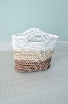 This is a handmade crochet tote bag. It will be perfect for your trip to the beach or to the town!  This bag is made from 3 color polyester rope