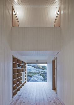 Vega Norge, Erik Kolman Janush | built in bookcases in the hall, giant gorgeous window