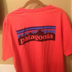 Patagonia Tshirt Bright coral Patagonia t shirt. It is a men's men's medium which fits like a women's large. Good as new! Worn twice. Patagonia Tops Tees - Short Sleeve