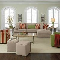 Excellent Choices of Funky Living Room Furniture : Funky Living Room Decoration With Gray Sofa And Striped Red Also Green Armchairs Complete With Square Bunks And Rectangular Maple Wood Table On The Metallic Legs Also White Rug On The Dark Brown Wood Floor