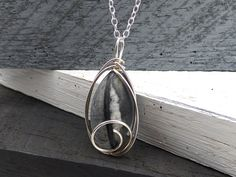 Black Stone Necklace, Natural Stone Necklace, Wire Wrapped Stone Pendant, Sterling Silver, Picasso Black Marble Rock Jewelry by SimpleGem on Etsy https://www.etsy.com/listing/235562835/black-stone-necklace-natural-stone