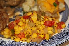 Simple maque choux, a tomatoed corn, is a very simple side dish of tomatoes and corn cooked in sauteed onion and bell pepper. Tomato Side Dishes, Side Dishes Easy, Vegetable Side Dishes, Corn Recipes, Side Dish Recipes, Vegetable Recipes, Southern Dishes, Southern Recipes, Tomatoes