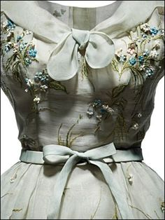 DIOR -- Smart afternoon dress in pale blue organdi, emboidered with pink an blue forget-me-not, Spring-summer 1953