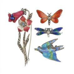 A selection of four early to mid 20th century enamel brooches.