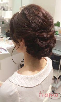 ルーズシニヨンとナチュラル編み込みスタイル♡リハ編 大人可愛いブライダルヘアメイク『tiamo』の結婚カタログ