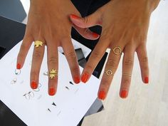 Love the orange nail polish and gold rings combo!
