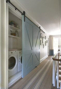 Barn door accents are really in right now! Check out this cool laundry room barn door idea! Country Laundry Room with specialty door, Industrial barn door hardware, Undermount sink, Rustica Hardware Full X Barn Door Style At Home, Stucco Homes, Small Laundry, How To Separate Laundry, Hidden Laundry Rooms, Outdoor Laundry Rooms, Compact Laundry, Outdoor Rooms, Laundry Room Design