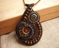 Hand crafted goodies: bead embroidered pendant with an ammonite and jades!