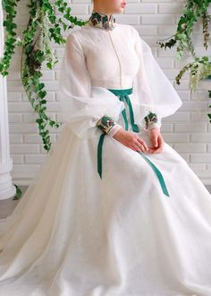 Details - White dress color - Lace and organdy dress fabric - Handmade embroidered neck and sleeve leaves details - Long sleeves with waist definition and a velvet green ribbon detail - For special occasion Stylish Dresses, Elegant Dresses, Pretty Dresses, Beautiful Dresses, Frock Fashion, Fashion Dresses, Dress Outfits, Indian Designer Outfits, Designer Dresses