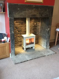 ACR Malvern Multi fuel stove in cream we installed recently.  These wood burning stoves are British made and really good quality.