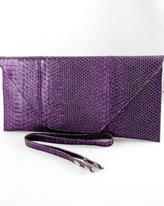 """Item Description: ENVELOPE STYLE CLUTCH BAG  Item Name: Clutched  Color(s): Dark Purple  Length: 7 1/2"""" Long  Width: 15"""" Wide  Also comes in: Pink, Blue, Red, Dark Red, Black, Dark Brown, Gold and Pewter  $40.47"""