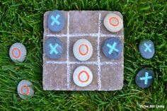 Garden Tic-Tac-Toe with painted rocks. See post for a second version.