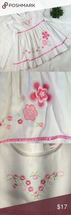 "Baby Girl Embroidered Cotton Dress Size 12-18 Mo Adorable White Dress Embroidered With Pink Flowers. Bought overseas. Brand Dieguito. Size label says 4 but It fits a 12-18 months old girl. Pre loved in great condition! Made of 100% cotton.  Shoulder measures 8 1/2"" Bust measures 11"" Total length 18"" Dieguito Dresses Formal"