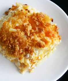 Cheesy Hash Browns - Hash brown potatoes are baked in a creamy, cheesy sauce for a brunch main dish. Cheesy Hashbrown Recipe, Cheesy Potatoes With Hashbrowns, Cheesy Potato Casserole, Squash Casserole, Hash Brown Casserole, Cheese Potatoes, Baked Potatoes, Turkey Casserole, Veggies