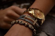 the combination with black, gold and sparkle is really cute, especially the skull bracelet and the sideways cross