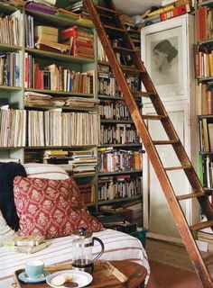 Library must-have: tall ladder. Nice photo of Virginia Woolf also.