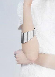 Sleek statement bangle; bold minimal jewellery // Agata Bielen