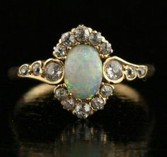 Opal & diamond art nouveau ring.