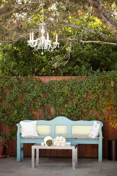 I love chandeliers, overhead lanterns, flowers in buckets hanging from trees, lighting.  Love the couch and want to decorate it with pillows with 6.02 on one, and 2013 on the other (our wedding date), or something else creative!